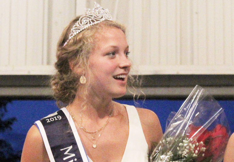 Riley Fitzpatrick smiles after receiving crown