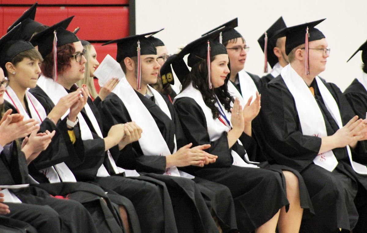 Students clapping during ceremony