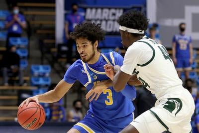 UCLA's Johnny Juzang drives against Michigan State's Gabe Brown during the first half in the NCAA Tournament First Four game at Mackey Arena in West Lafayette, Indiana, on Thursday, March 18, 2021.