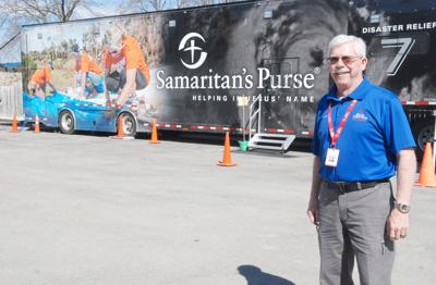 Chaplain in front of Samaritan's Purse trailer