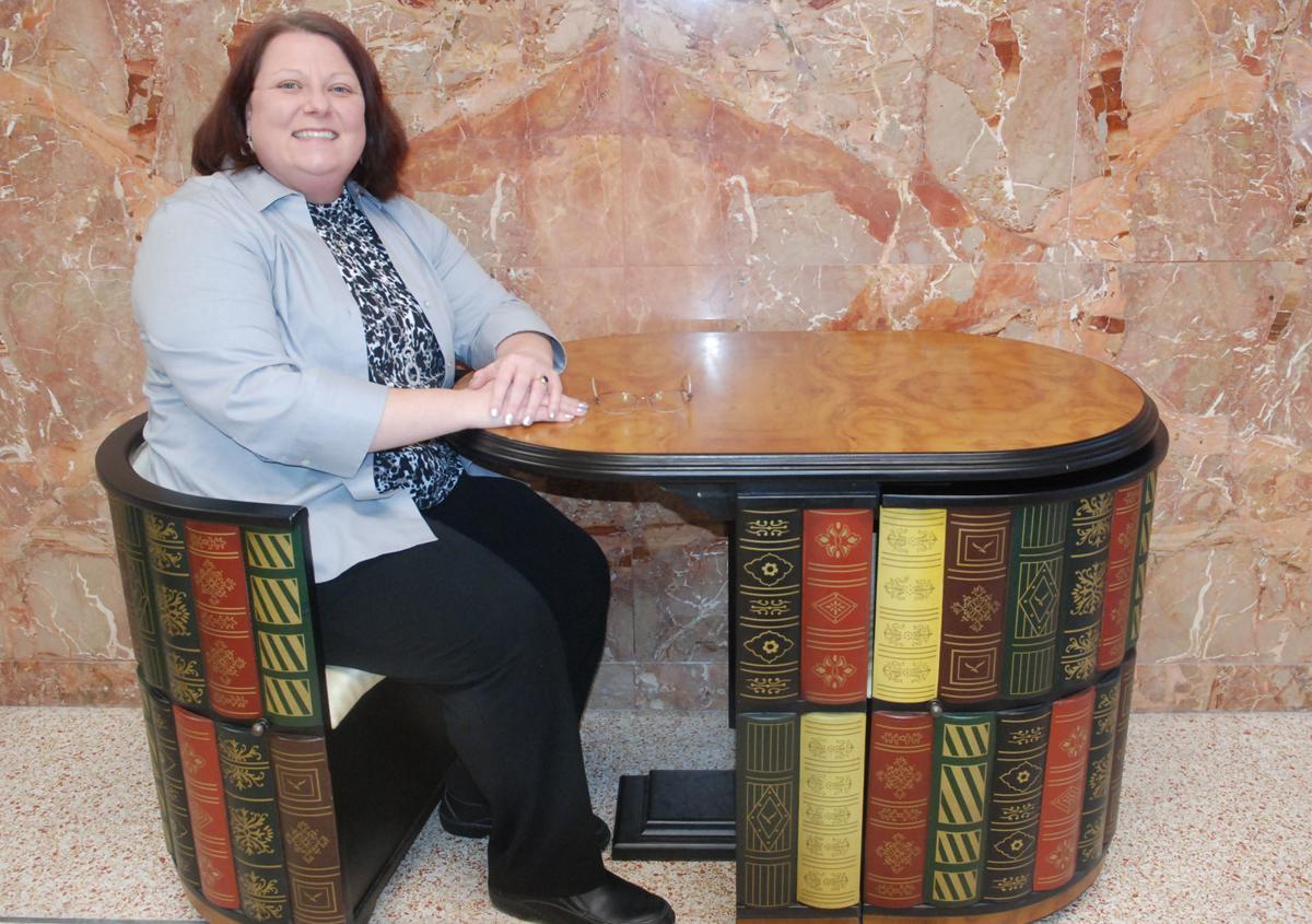 Tina Walker at table in libary entryway