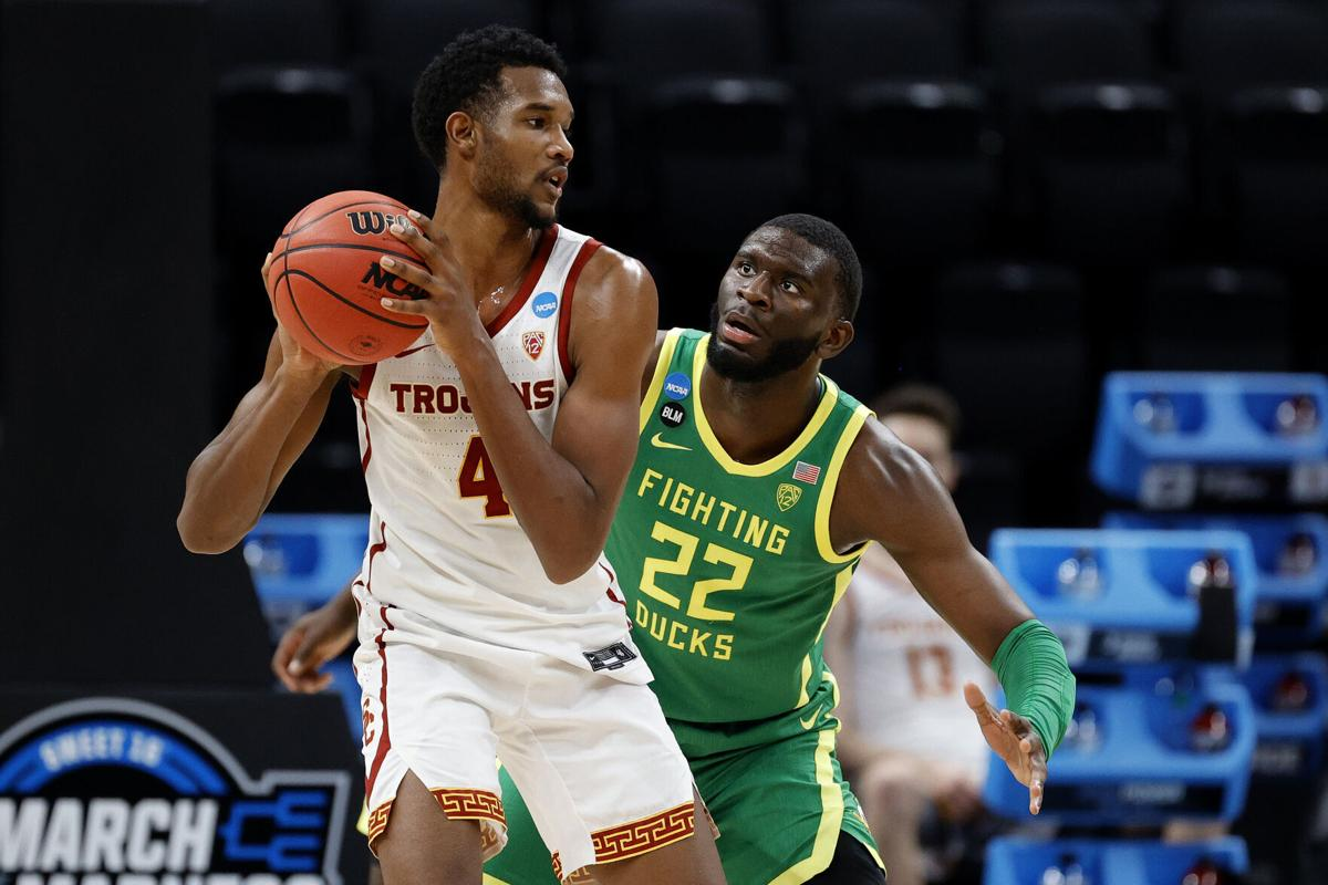 Evan Mobley #4 of the USC Trojans looks to pass against Franck Kepnang #22 of the Oregon Ducks in the second half of their Sweet Sixteen round game of the 2021 NCAA Men's Basketball Tournament at Bankers Life Fieldhouse on March 28, 2021, in Indianapolis, Indiana.