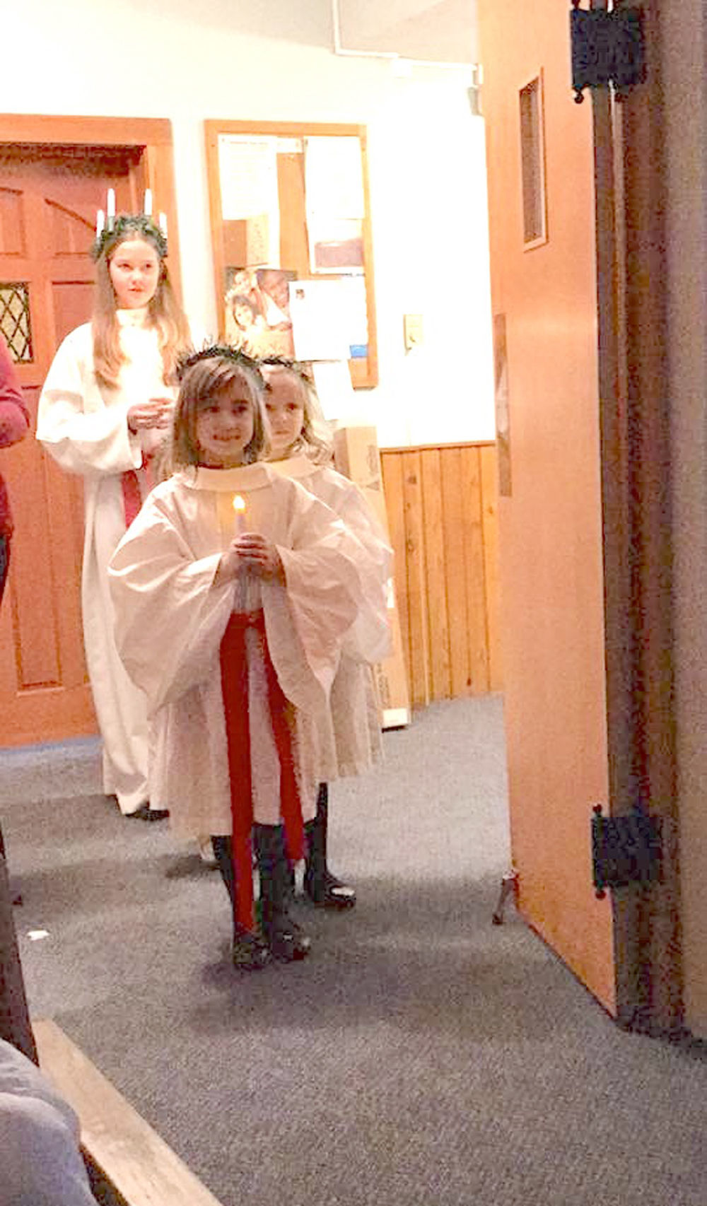 Santa Lucia with girls and candles