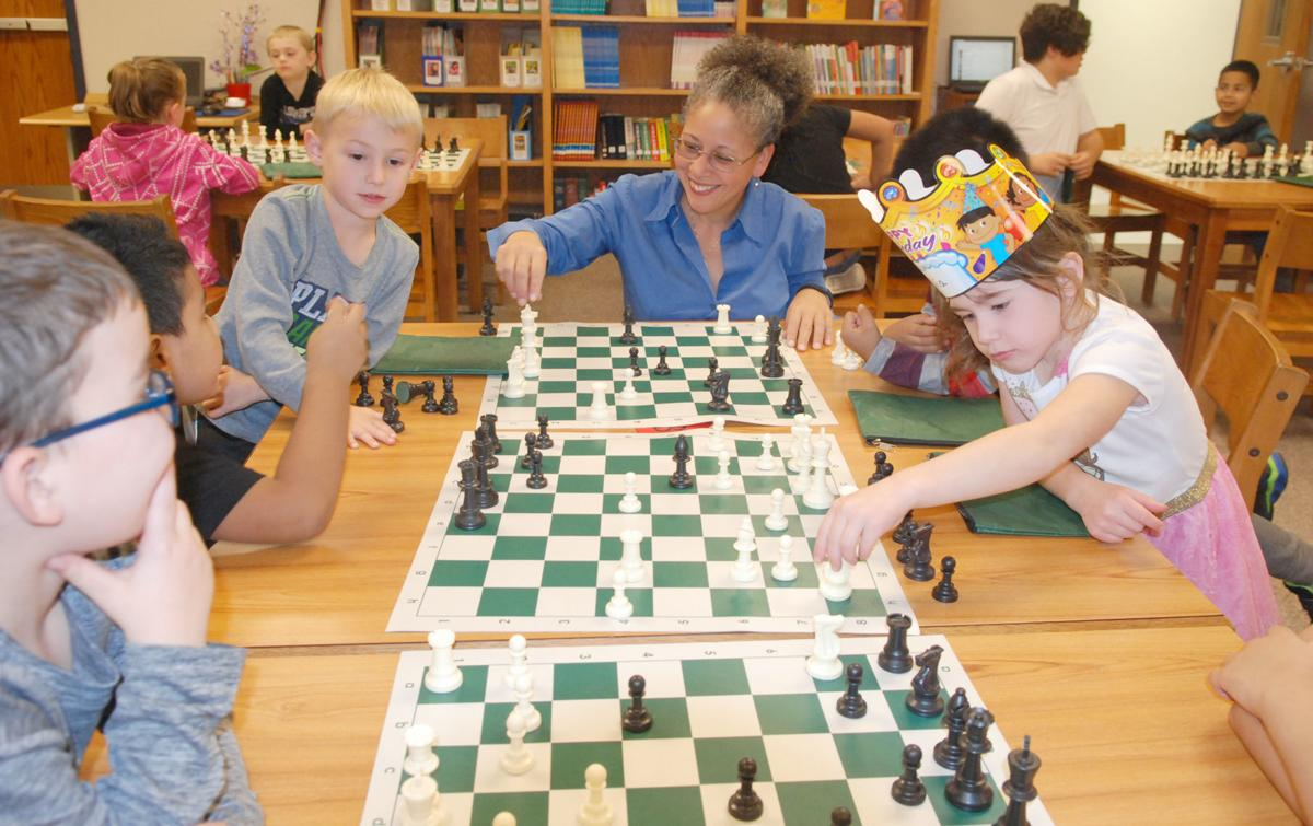 Chess club leader and kids