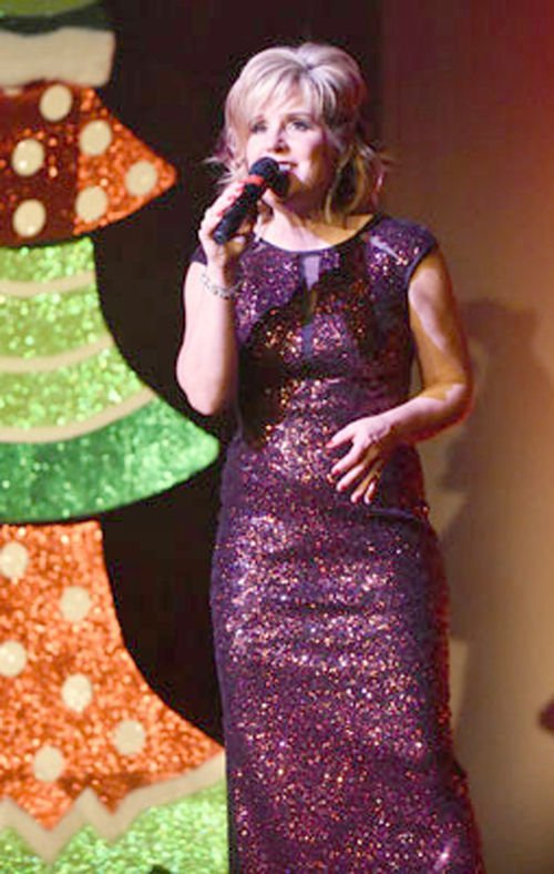 Singer coming to First Lutheran by tree.jpg