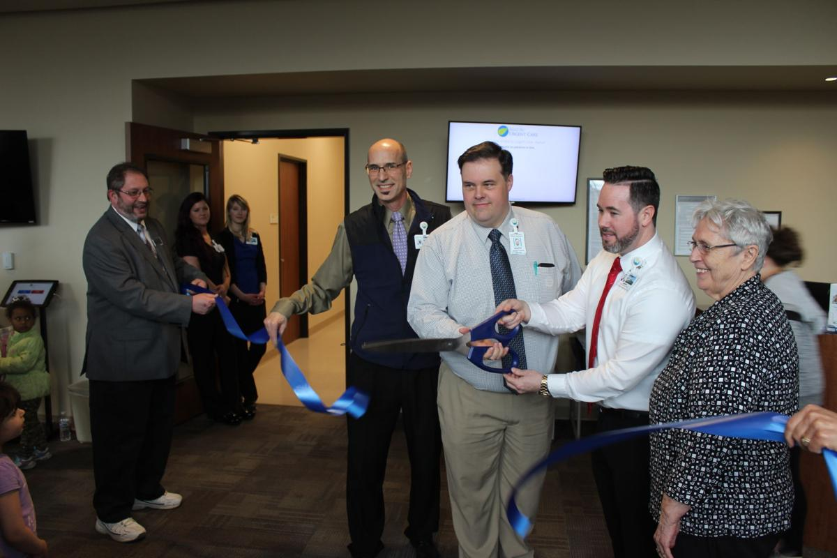 Alan Craft, Mark Palmer and Jarom Schmidt cut the ribbon on a new Urgent Care facility in Palmer with Mayor Edna DeVries.JPG