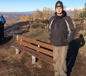 Benchmark; Local Boy Scouts repair bench atop Butte