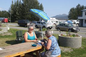 Volunteers gather signatures in Palmer to recall Dunleavy