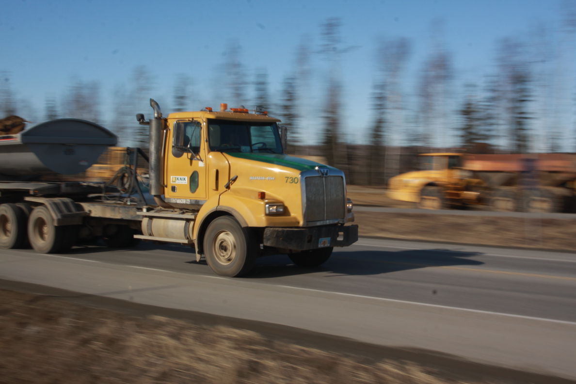 A Knik Construction dump truck rumbles down the Parks Highway last spring. The Alaska Department of Transportation and Public Facilities has announced ...