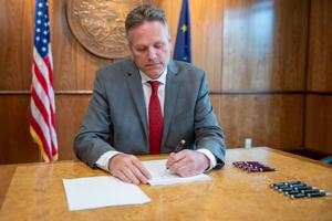 Dunleavy relents on UA vetoes; spreads $70 million in cuts over 3 years