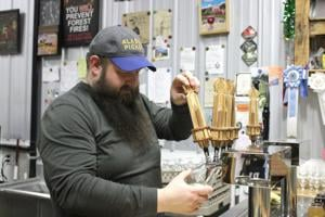 New heights; Bleeding Heart Brewery will help celebrate move downtown with Running of the Beers, lighting of the water tower
