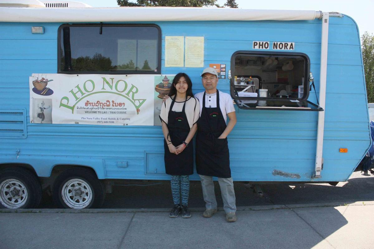 Noy phetphommasouk right and his 14 year old daughter noralee pose for a photo outside their lao and thai food truck pho nora in palmer on friday
