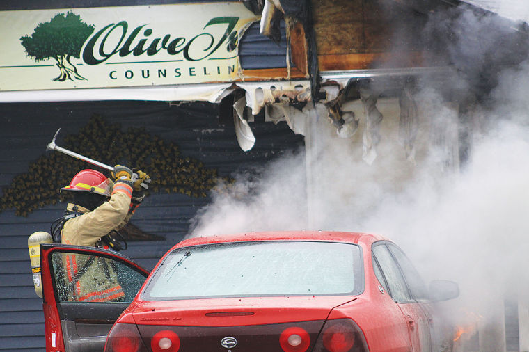 Car fire spreads to business