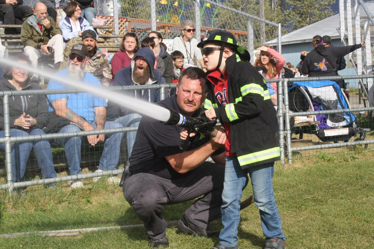 Kids and firefighters at the Alaska State Fair