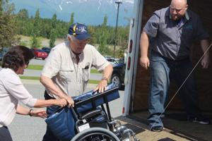 Geneva Woods donates 25 wheelchairs to the Honor Flight program