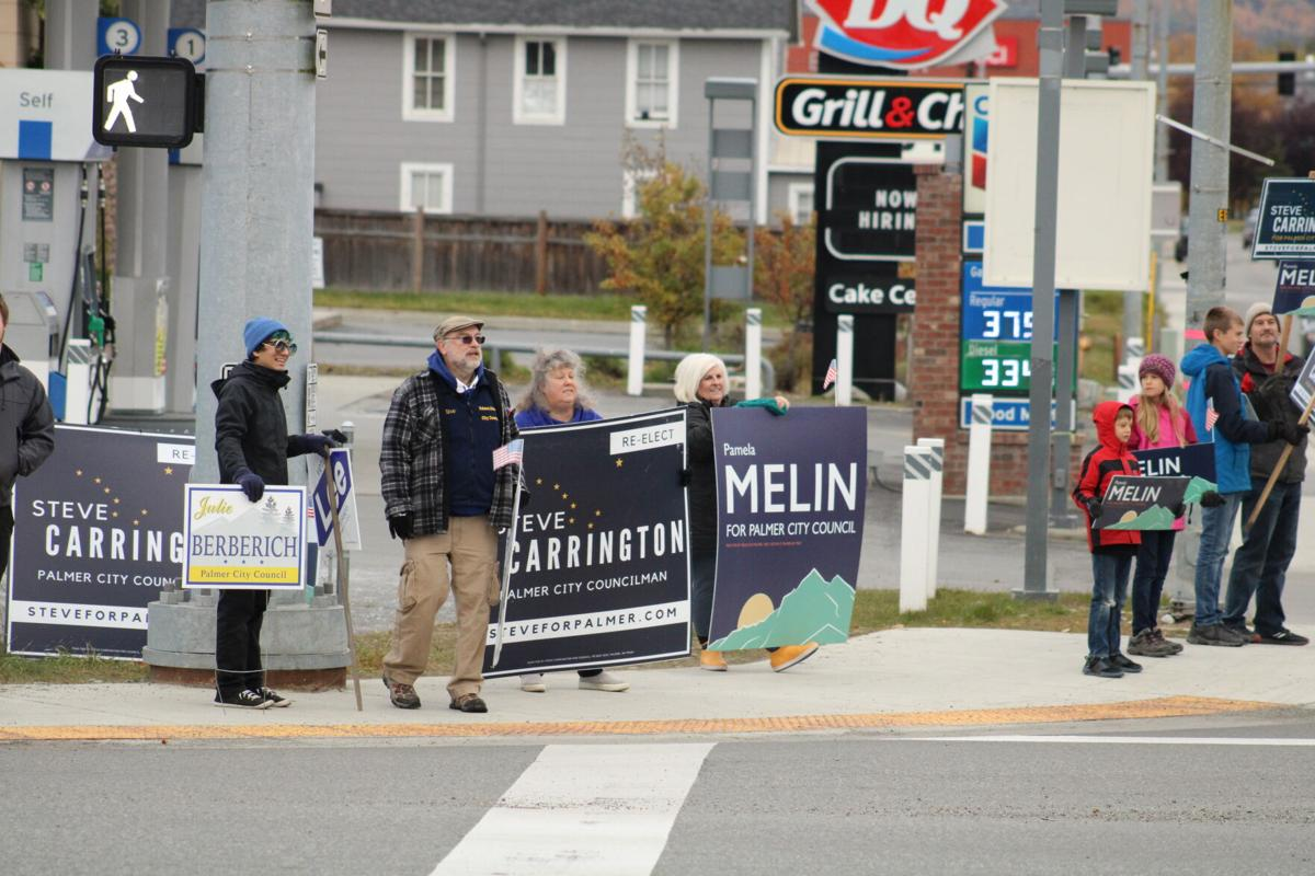 Sign wavers on Election Day in Palmer