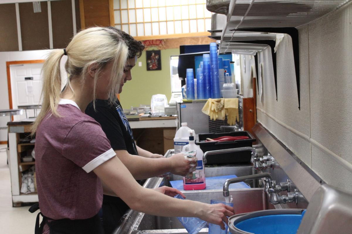 Jacob and Angelina work together as a team on the dishes.JPG
