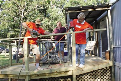 Volunteers build ramp for local home
