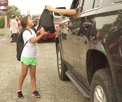 Kiwanis give out school backpacks