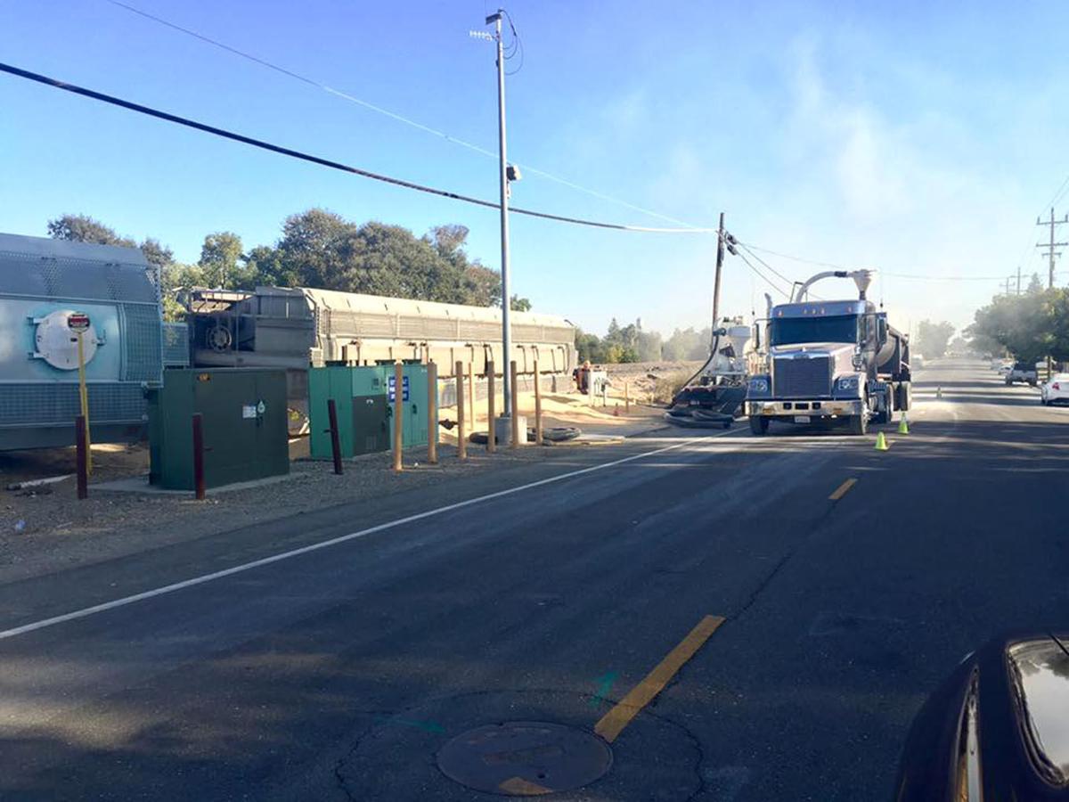 Train derailment closes three Galt streets, dumps corn