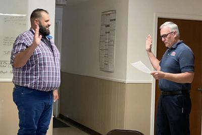 administers the oath