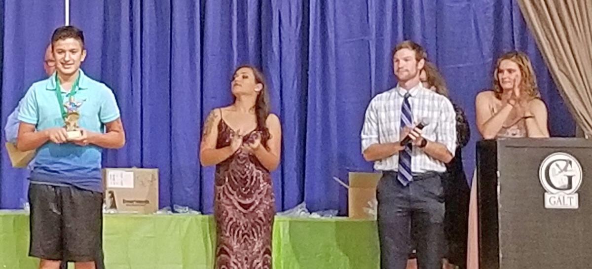 Luke Ortega accepts his award