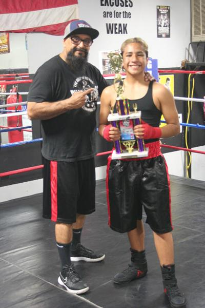 Matthew Medina and coach Russell Guerrero