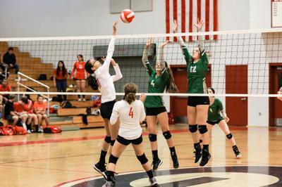 Kaya Weaver sends the ball over the net