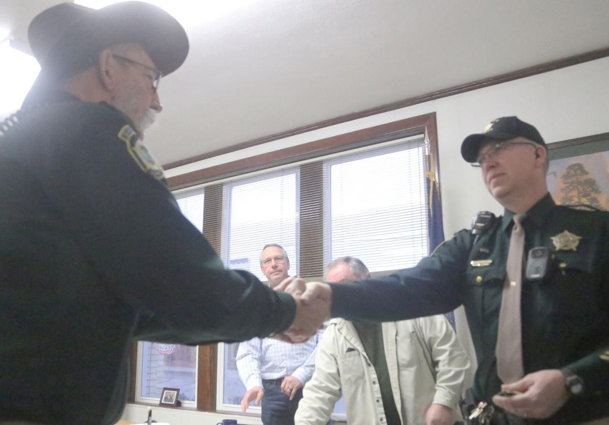 Commisioners Meeting badge handoff.jpg
