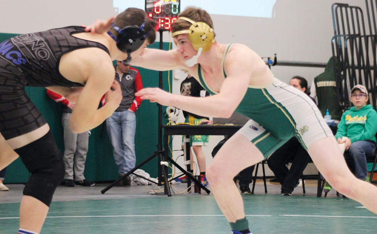 SM wrestling team makes it four in a row; 12 on to state