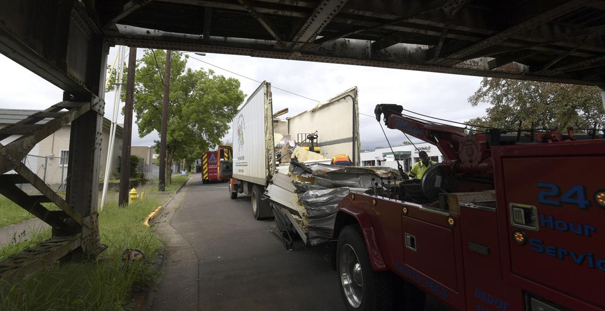 050721-adh-nws-Truck in Trestle02-my