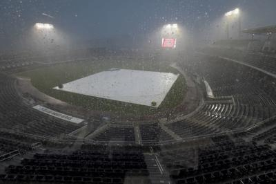 cws beavers razorbacks rained out will open finals tuesday