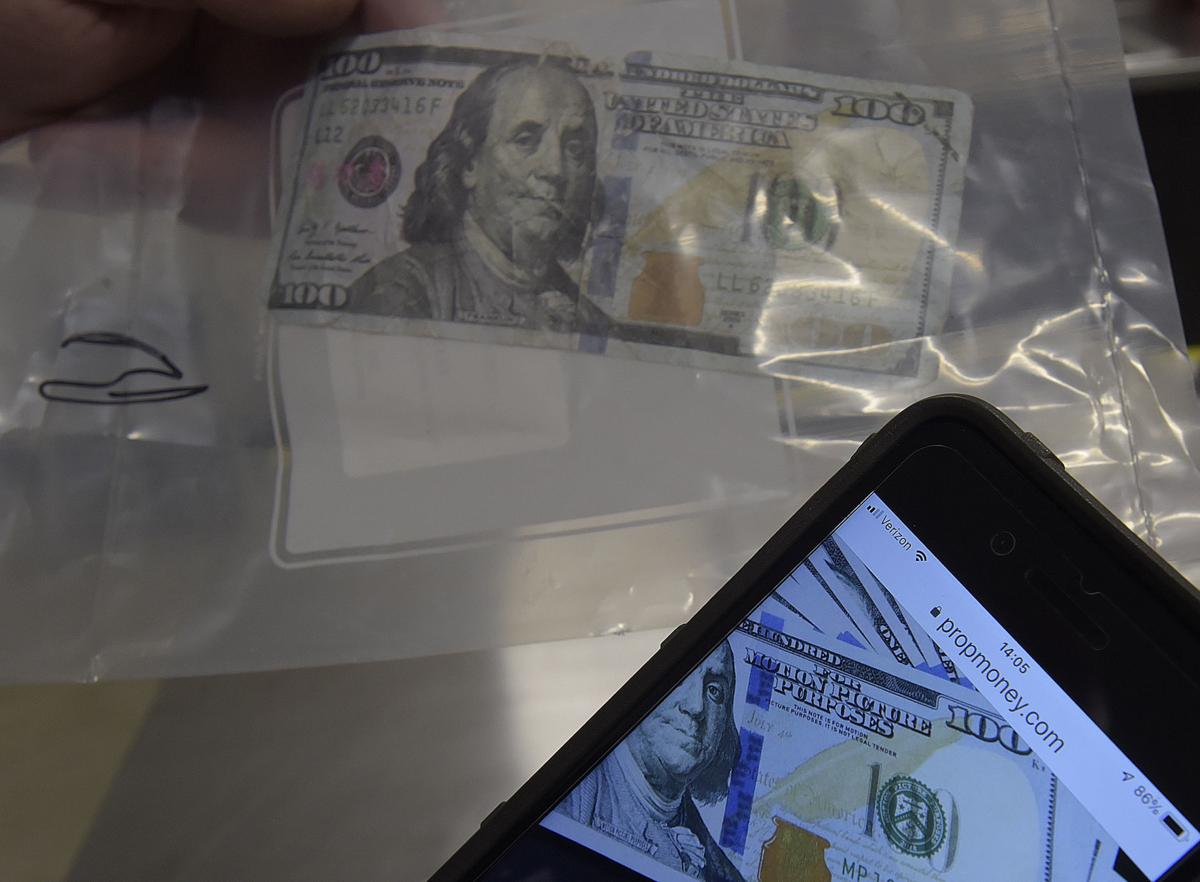 071219-adh-nws-Fake Money02-my