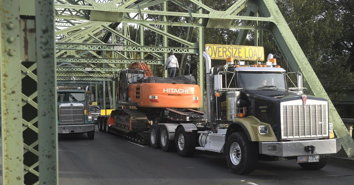 101321-adh-nws-Excavator Stuck-my