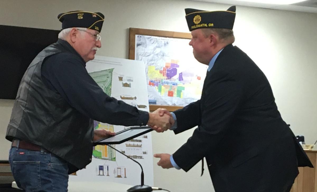 Mayor Eric Niemann, American Legion Post 100 commander Elwin Callahan