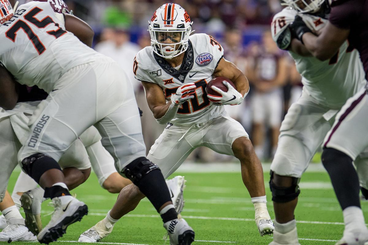 Oklahoma State Cowboys running back Chuba Hubbard (30) carries the ball during the fourth quarter of the Texas Bowl against the Texas A&M Aggies on Dec. 27, 2019 at NRG Stadium in Houston, Texas.