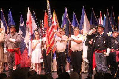 Flag salute opens theater fest