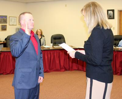 Hewitt takes oath of office