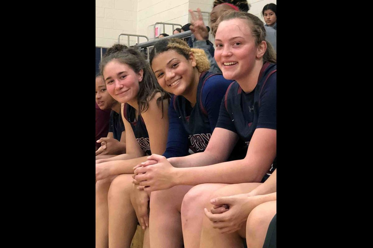 Perry juniors Tatyanna Clayburne, left, Nicole Smith, middle, and Madison Conner