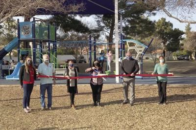 HOA President Bill Suttel, Councilwoman Kathy Tilque, Mayor Brigette Peterson, playground committee members Paul Ross and Galina Vereshchagina