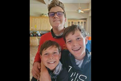 Cooper,  Travis and Daniel Johnson