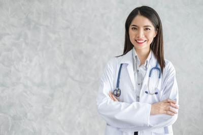 Asian woman doctor with stethoscope in uniform