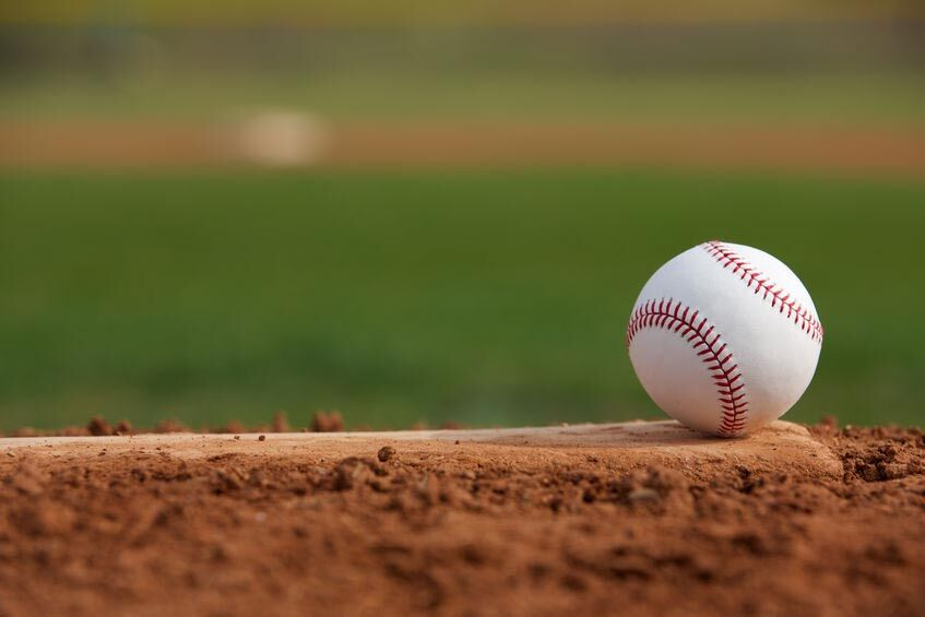 22268280 - baseball on the pitchers mound close up with room for copy