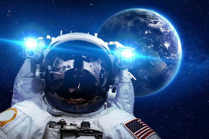Astronaut in outer space against the backdrop of the planet