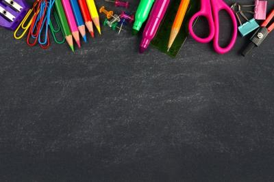 School supplies top border on a chalkboard background