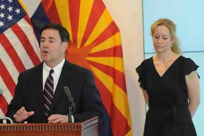 Gov. Doug Ducey and state health services Director Dr. Cara Christ