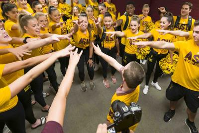 Brett Logan leads his new teammates in a show of unity after he signed a letter of intent to join the Arizona State University cheer team