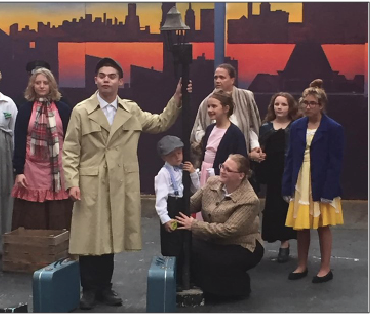 Cast members rehearse for this weekend's  production of Annie.