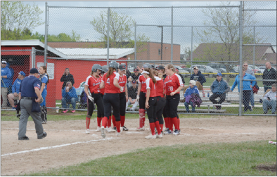 Molly Gerow is met at home plate after her second inning home run versus Oscoda.
