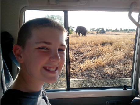 Elijah while touring through Kruger National Park to view and take photos of the big five, including elephants.